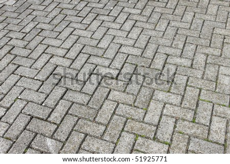 Gray paving cobblestone blocks pattern background.