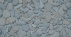 Gray pebbles or smooth rocks or stones