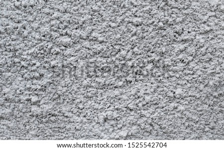 Gray plastered wall, patterned background, indented protruding texture  Stok fotoğraf ©