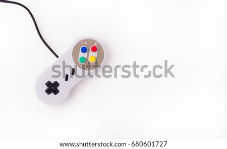 Gray retro joystick on a white background. Video game console GamePad on a white background. Top view - Shutterstock ID 680601727