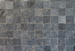 Gray rock wall , Artificial rock wall , stone wall background texture.