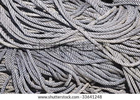 Gray ropes in  the harbour. Abstract background