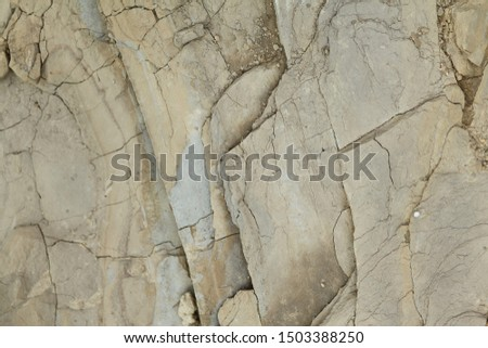 Gray rough rough rock with large cracks. #1503388250