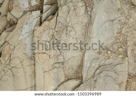 Gray rough rough rock with large cracks. #1503396989