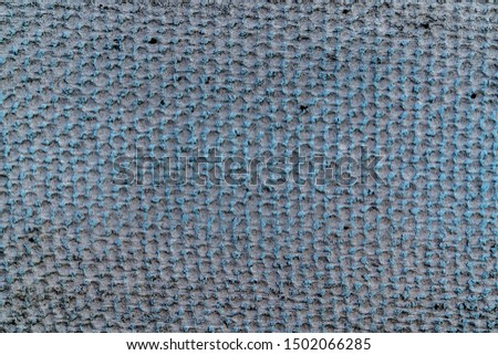 Gray rough texture with net of blue rounds. Pattern of rounds. Background for text or design #1502066285