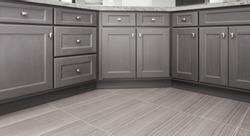 gray shaker style kitchen / vanity / bathroom cabinet with chrome color rectangular handles, porcelain floor tiles