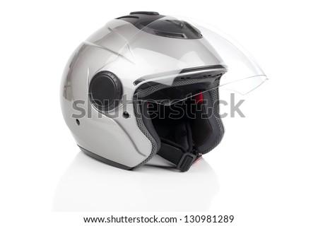 gray, shiny motorcycle helmet isolated - stock photo