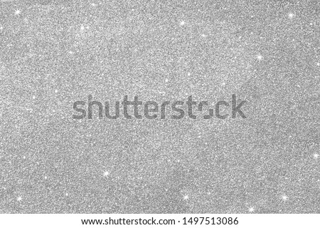 Gray silver glitter for texture or background.  Silver Seamless glitter sparkle pattern texture.