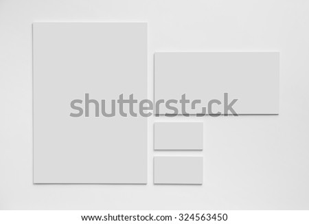 Gray simple stationery mock-up template on white background. Envelope, business cards and A4 paper.