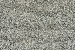 Gray small rocks ground texture. black small road stone background. gravel pebbles stone seamless texture, marble. dark background of crushed granite gravel, close up. grey clumping clay
