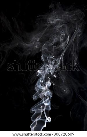 gray smoke on a black background. Shot in studio