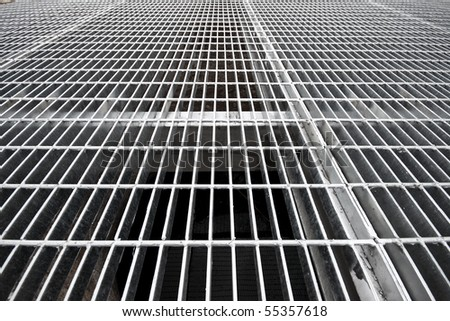 Gray still grates over a well - stock photo