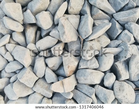 Gray stone background. gray pebbles background.