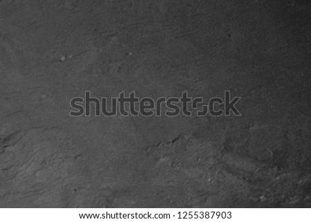 Gray stone texture closeup. Graphite gray #1255387903