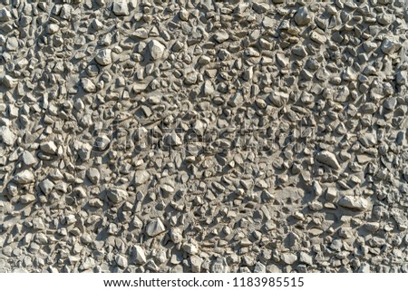 Gray stones on a gray wall as a background.  Stone grey abstract background
