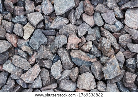 Gray stones, top view, texture, background. Stone texture photo. Background texture. Stone for construction. Gray stone. Crushed stones, building material. Stone wall texture background natural color.