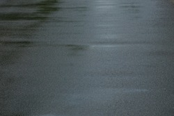 gray texture of wet asphalt on the road