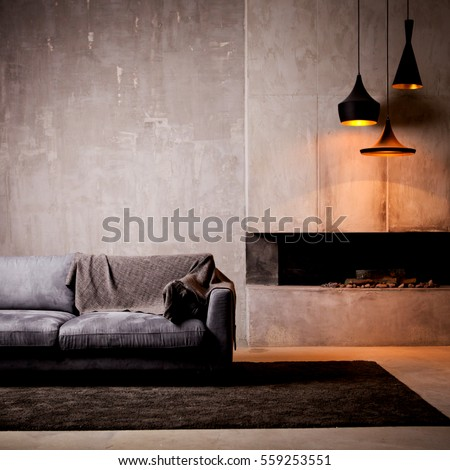 gray velour sofa in a dark room ...