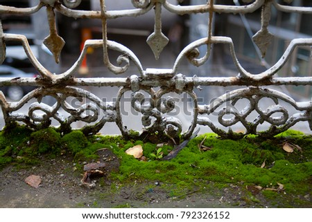 Gray vintage metal decorative lattice of the balcony, with rust and moss on the floor. #792326152