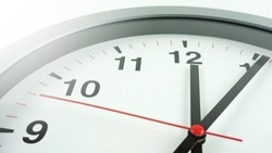 Gray wall clock face beginning of time 12.06 am or pm on White background, Copy space for your text, Time concept.