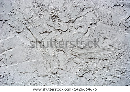 Gray white colored heavily textured stucco wall for background. #1426664675