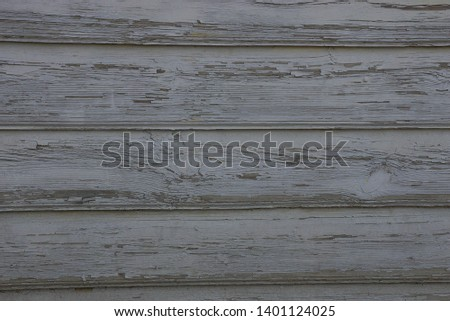 gray wooden texture of wide worn planks in the wall of the fence