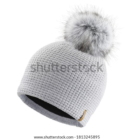 Gray Wool Knit Ski Hat with Faux Fur Pompom Isolated on White. Knit Cap Folded Brim. Tuque or Toque Outdoors Headgear. Bobble Hat Topped with Pom Pom or Loose Tassels. Knitted Warm Hat Stock photo ©
