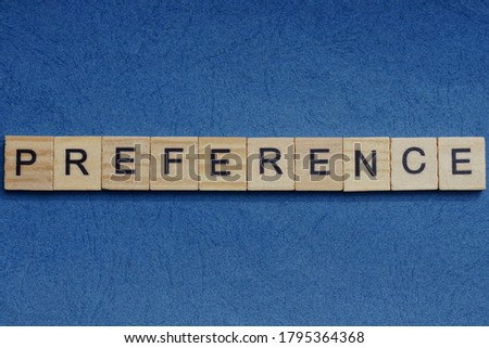 gray word preference in small square wooden letters with black font on a blue background Zdjęcia stock ©