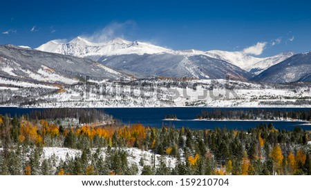 Grays and Torreys Peaks in the Colorado Rocky Mountains with Snow on Aspen Trees and Lake Dillon in the Foreground