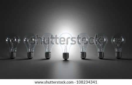 Grayscale image of light bulbs in a row