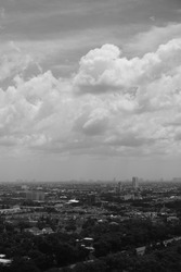 Grayscale Photo of Sky Above Cityscape