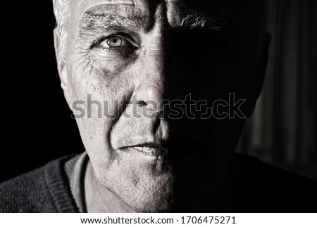 Grayscale portrait of an old man face