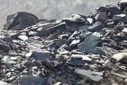 Graystone debris in a slide on a sunny day