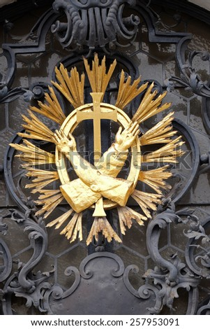 GRAZ, AUSTRIA - JANUARY 10, 2015: Franciscan monogram on the main entrance, Mariahilf church in Graz, Styria, Austria on January 10, 2015.
