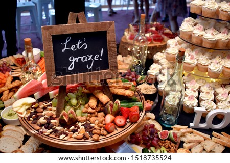 Grazing table at a party with sign Stockfoto ©