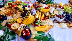 Grazing table with meats fruit cheese