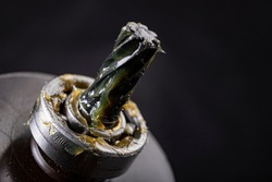 Grease lubrication of the bearing and the pin of the electric rotor. Service work of engine parts. Dark background.