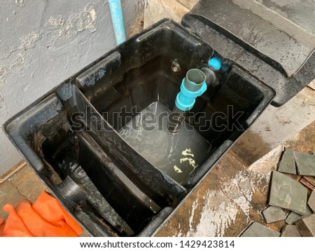 Grease trap behind the coffee shop Foto stock ©