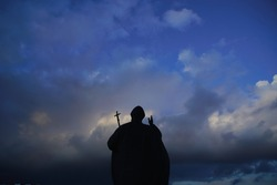 Great big Christian holy statue monument and shrine of Pope John Paul II from Catholic Church Vatican City State against background of cloudy evening spring winter sky in blue, purple tones