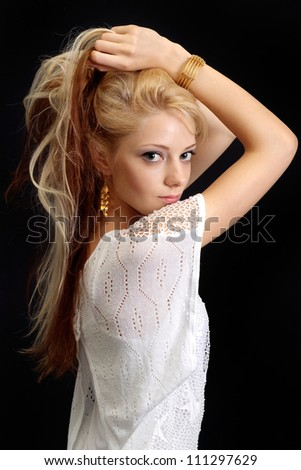 Great blond over black background