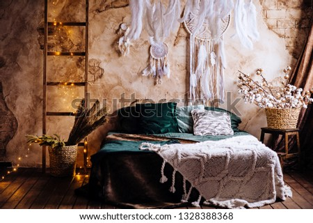 Great Boho and Bohemian interior with romantic lights and backet of cotton
