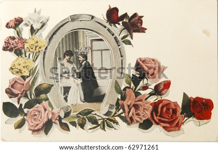 GREAT BRITAIN - CIRCA 1915: Vintage valentine card of 1915 with loving couple in horseshoe image with roses, circa 1915. - stock photo
