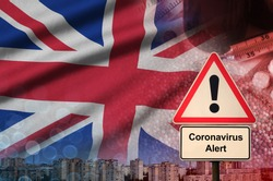 Great britain flag and Coronavirus 2019-nCoV alert sign. Concept of high probability of novel coronavirus outbreak through traveling tourists
