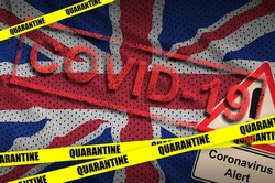 Great britain flag and Covid-19 quarantine yellow tape with red stamp. Coronavirus or 2019-nCov virus