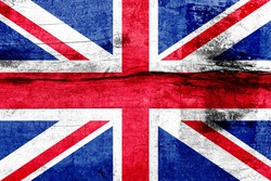 Great Britain flag painted on a weathered wooden board. Flag of United Kingdom. Textured abstract background