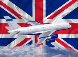 Great Britain flag with white airplane and clouds. The concept of tourist international passenger transportation.