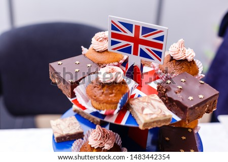 Great Britain Uited Kingdom Union Jack flag on a table with cakes and muffins. British or english party Stockfoto ©