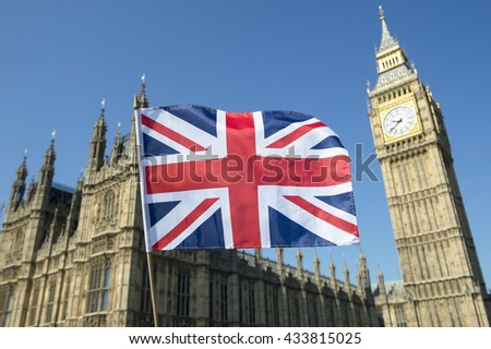 Great British Union Jack flag flying in front of Big Ben and the Houses of Parliament at Westminster Palace, London, a symbol of national pride during the EU Brexit and election proceedings #433815025