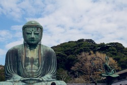 Great Buddha of Kamakura in Kotoku-in shrine Japan. Sitting Buddha at sky background
