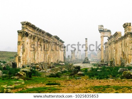 Great Colonnade at Apamea in fog, partially destroyed now, Syria